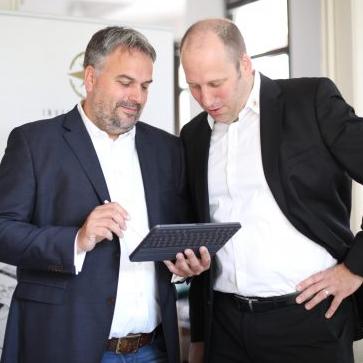 Finanzberater Jan Theilmann und Björn Tost
